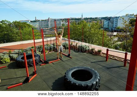 Outdoor street fitness training ground over the city.