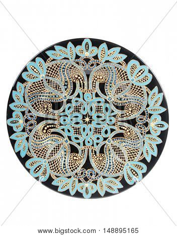 Vintage painted porcelain plate on a white background