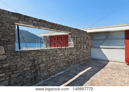 Lake view from the window of a stone wall, outdoors