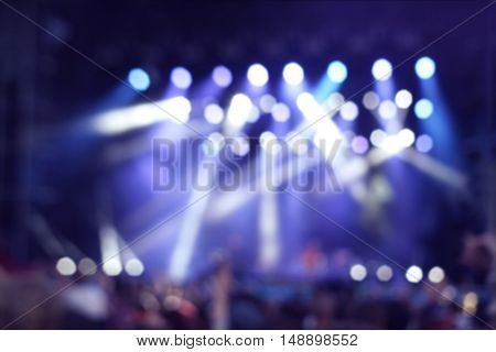 Blurred background of concert illuminations on stage