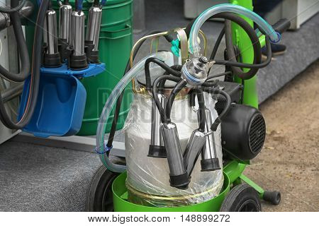 Mechanized milking equipment on agricultural exhibition