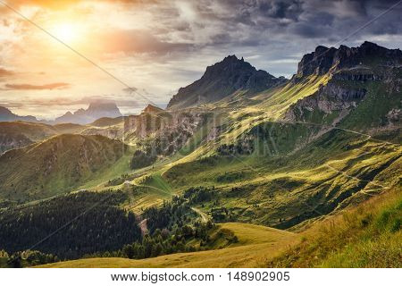 Great view of the Val di Fassa valley. National Park Dolomites (Dolomiti), Pordoi pass. Location Livinallongo del Col di Lana, province Belluno, Veneto, Tyrol, Italy alps, Europe. Beauty world.