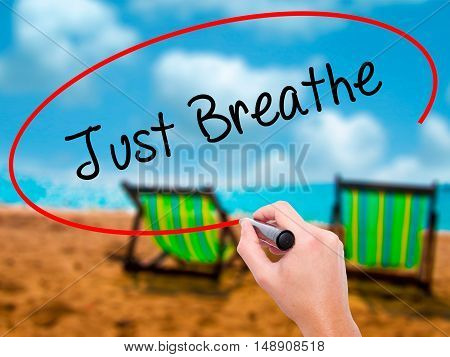 Man Hand Writing Just Breathe With Black Marker On Visual Screen