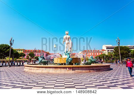 NICE, FRANCE - AUGUST 28, 2016: Fountain Soleil on Place Massena in Nice, France. A beautiful square with a fountain in the middle.