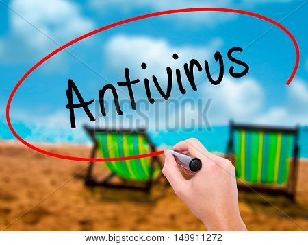 Man Hand Writing Antivirus   With Black Marker On Visual Screen