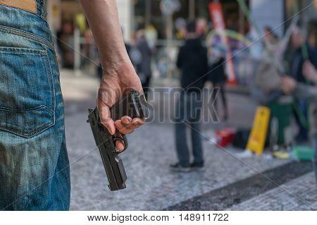 Gun Control Concept. Armed Man - Attacker Holds Pistol In Hand I