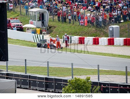 The racing car take off from line in sandy zone during The Formula 1