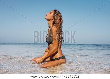 Young Woman Relaxing In Sea Water