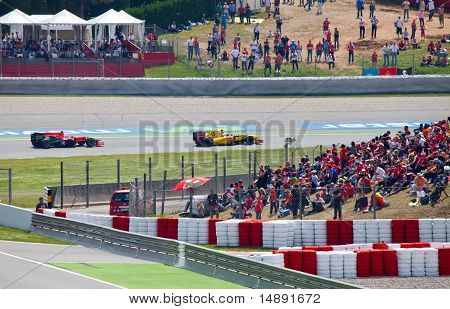 Racing cars on a circuit during The Formula 1 Grand Prix at autodrome