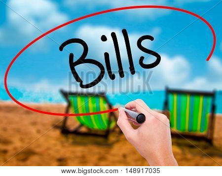 Man Hand Writing Bills With Black Marker On Visual Screen