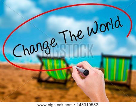 Man Hand Writing Change The World With Black Marker On Visual Screen