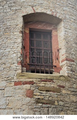 old window in the fortress iron past century grid history