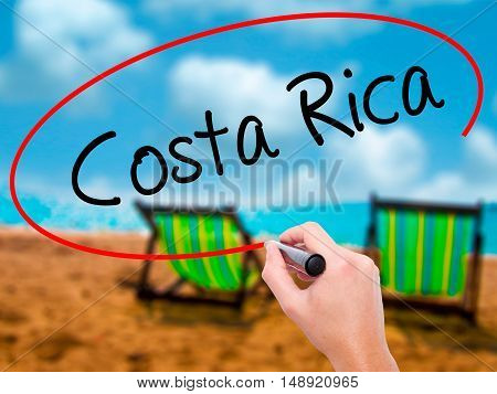 Man Hand Writing Costa Rica With Black Marker On Visual Screen