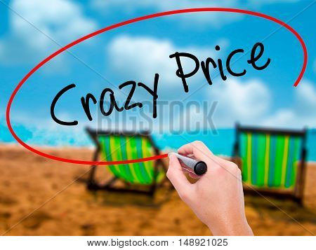 Man Hand Writing Crazy Price With Black Marker On Visual Screen