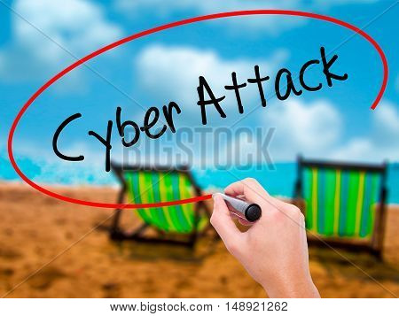 Man Hand Writing Cyber Attack With Black Marker On Visual Screen