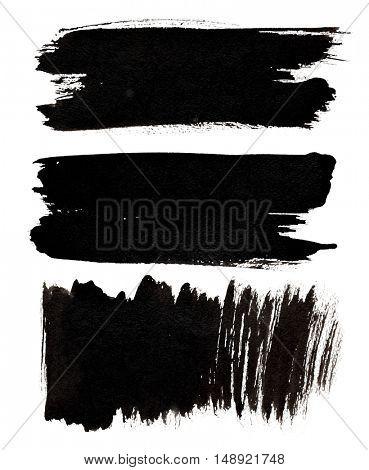 Set of black brush strokes isolated over the white background