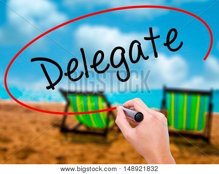Man Hand Writing Delegate With Black Marker On Visual Screen