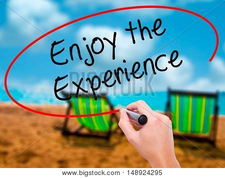 Man Hand Writing Enjoy The Experience With Black Marker On Visual Screen