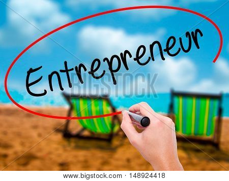 Man Hand Writing Entrepreneur With Black Marker On Visual Screen