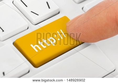 Computer notebook keyboard with Internet key - technology background