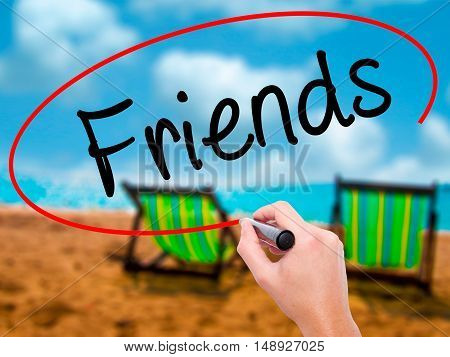 Man Hand Writing Friends With Black Marker On Visual Screen
