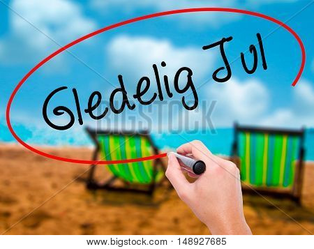 Man Hand Writing Gledelig Jul  (happy Christmas In Norwegian) With Black Marker On Visual Screen