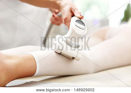 Picture of woman having calf treatment in beauty salon