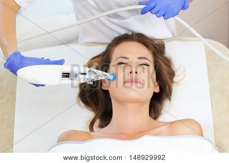 Picture of woman having facial mesotherapy in beauty salon