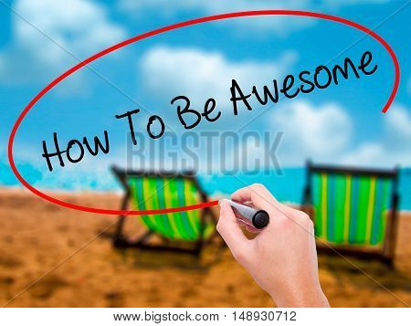 Man Hand Writing How To Be Awesome With Black Marker On Visual Screen