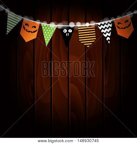 Halloween greeting card invitation. Party flags decoration. Pumpkin design. Old wooden background. Vector illustration.
