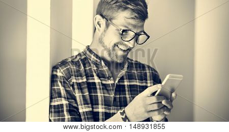 Young Man Using Browsing Smartphone Concept