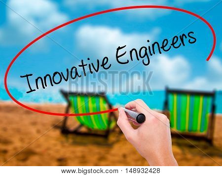 Man Hand Writing Innovative Engineers With Black Marker On Visual Screen