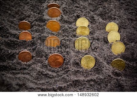 Money growth. Euro coins growing from soil. Selective focus