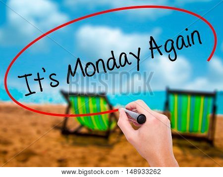 Man Hand Writing It's Monday Again With Black Marker On Visual Screen