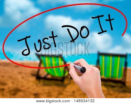 Man Hand Writing Just Do It With Black Marker On Visual Screen
