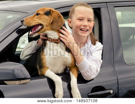 Happy Smilling Girl And Beagle Puppy Sitting In Car