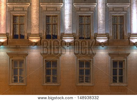 St. Petersburg Russia - August 4 2016: Several windows in a row on night illuminated facade of Marble Palace museum front view