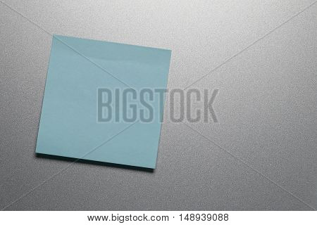 Empty blue paper sheet on refrigerator door for design and input text to concept food and drink etc.