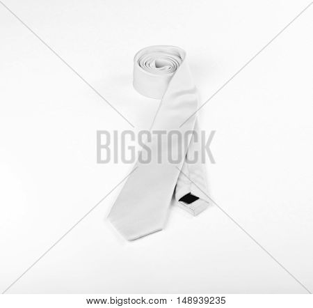White necktie on white background roll of necktie on white background. A White tie on white background