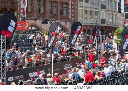 Sport fans waiting for the triathletes on tribunes to encourage them during the yearly Mainova Ironman European Championship (triathlon) - July 5 2015, Frankfurt am Main, Germany