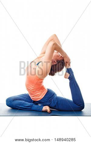 Sporty fit yogini woman doing yoga asana Eka pada kapotasana - one-legged pigeon pose posture isolated on white