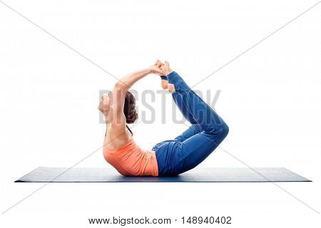 Sporty fit woman dooing yoga back bend asana Dhanurasana - bow pose isolated on white