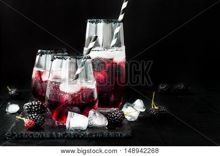 Blackberry drink in glasses with black sugar rim for fall and halloween parties