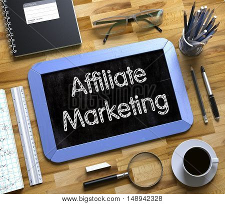 Affiliate Marketing Handwritten on Blue Chalkboard. Top View Composition with Small Chalkboard on Working Table with Office Supplies Around. Small Chalkboard with Affiliate Marketing. 3d Rendering.