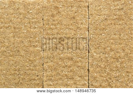 Crisp rye bran bread texture background with vertical seams