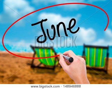Man Hand Writing June  With Black Marker On Visual Screen