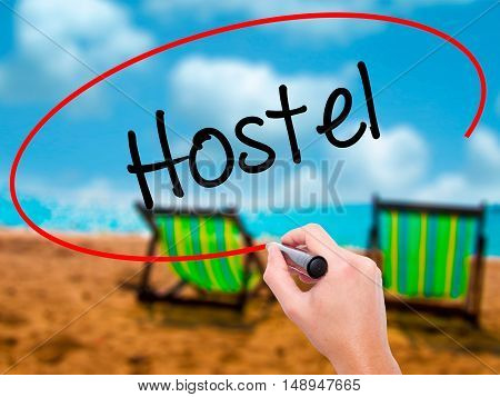 Man Hand Writing Hostel With Black Marker On Visual Screen