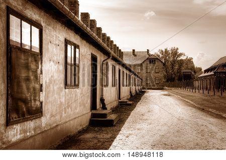 OSWIECIM POLAND - MAY 12 2016: Street in concentration camp Auschwitz-Birkenau in Oswiecim Poland.