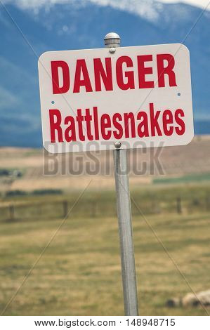 Rattlesnake warning sign in an american countryside