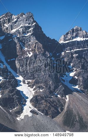 Rough Mountain With Cliffs And Snow